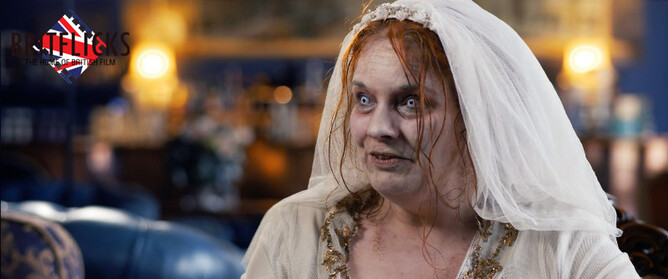 Emma Spurgin Hussey as Aunt Alexandra in zombie movie Hobbes House